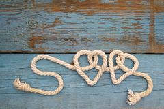 Leash  rope into heart shape on wood Royalty Free Stock Photo