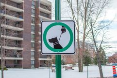 Leashed dogs allowed sign and modern condo buildings with huge windows and balconies in Montreal Stock Image