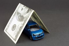 Leasing car loan. Concept of insurance, leasing car loan, new car buy. toy car dollar bill royalty free stock image
