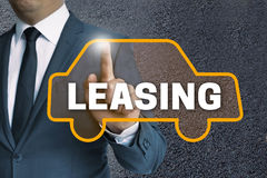 Leasing car touchscreen is operated by businessman concept Royalty Free Stock Images