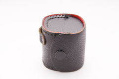 Leather. A vintage leather case with a button clasp sits on white Royalty Free Stock Photography