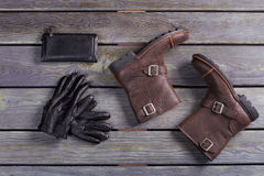 Leather accessories and shoes. Winter men's shoes and accessories are on a wooden background. Leather accessories and shoes Royalty Free Stock Images