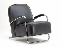 Leather arm chair. Black Leather arm chair with chrome arms on white background Stock Image