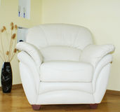 Leather armchair. White leather armchair in simple interior Royalty Free Stock Photography