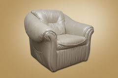 Leather armchair. Vintage comfort Leather armchair with yellow background Stock Photography