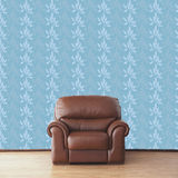 Leather armchair in room with vintage wallpaper Royalty Free Stock Image
