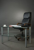 Leather armchairs and glass table at office Stock Images