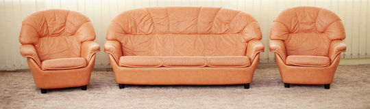 Leather armchairs and sofa - furniture Stock Image