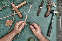 Leather artisan craftsman. Manufacturing with diy tools, workshop laboratory view from top, green table royalty free stock photography