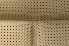 Leather background. Detail of car seat. Macro photo Royalty Free Stock Image