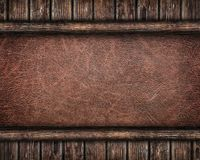 Leather background framed by old wooden planks Royalty Free Stock Image