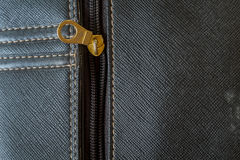 Leather background with metal zip. Royalty Free Stock Images