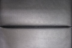 Leather background. Modern business car perforated leather seat. Interior detail Royalty Free Stock Photo