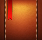 Leather background with a red sticker Stock Photo