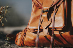 Leather backpack detail. Close up view of brown leather backpack at the countryside Stock Photography
