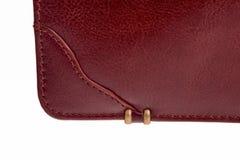 Leather bag closeup. Leather bag bottom corner over white background Stock Photo