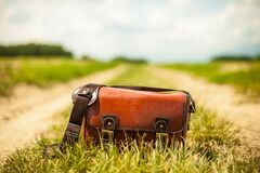 Leather bag on country lane