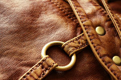 Leather bag detail. Brown artificial leather bag part for background Stock Photo