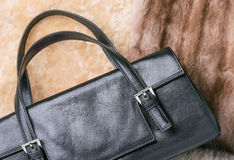 Leather Bag on Furs Stock Image