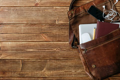 Leather bag with gadgets and notebooks Stock Image