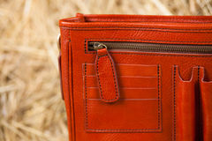 Leather bag in the hay Royalty Free Stock Photography