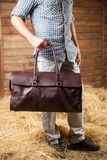Leather bag in the hay Stock Photography