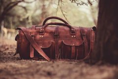 Leather bag under tree Stock Photography