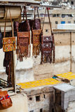 Leather bags being sold, over medina background. In Fes, Morocco Stock Image