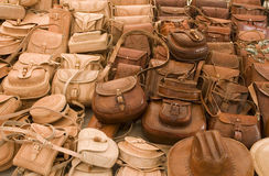Leather bags in a market in Mexico stock images
