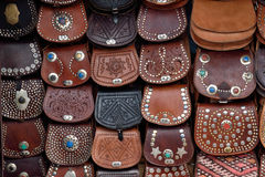 Leather bags to sell on street market. In Jemaa el-Fnaa Square on August 08, 2015 in a Marrakesh, Morocco. The square is part of the UNESCO World Heritage Stock Photography