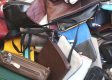 Leather bags of various sizes on sale in the market stall Royalty Free Stock Photos