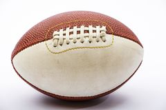 Leather ball for rugby game isolated on white background. A ball for American football. Leather ball for rugby game isolated on white background. A ball for royalty free stock photography