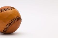 Leather baseball ball on the white table Stock Photos