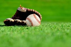 Leather baseball glove and ball Stock Photos