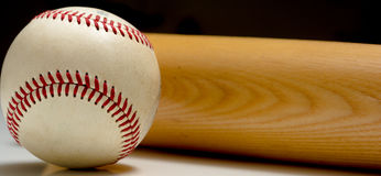 Leather Baseball and wooden Bat royalty free stock photography