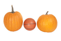 A leather basketball between two pumpkins fall harvest halloween Stock Photo