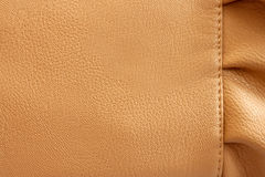 Leather beige background with the frill. Close-up Royalty Free Stock Photos