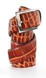 Leather belt. Leather snakeskin belt on white Royalty Free Stock Photo