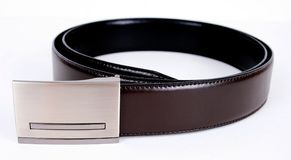 Leather belt. A leather belt isolated over white Royalty Free Stock Photo
