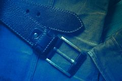 Leather belt with buckle and denim jacket Stock Image