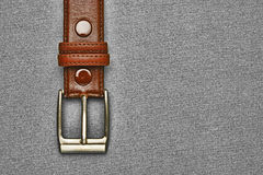 Leather belt with a buckle on a gray Stock Photo