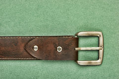 Leather belt with a buckle Royalty Free Stock Images