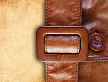Leather belt on grunge paper background Royalty Free Stock Photos