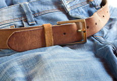 Leather belt on jeans background Stock Images