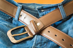 Leather belt on  jeans pants Stock Images