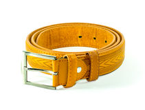 Leather belt. Men s brown leather belt on white bacground Royalty Free Stock Photography