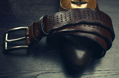 Leather belt and men's shoes Royalty Free Stock Photography