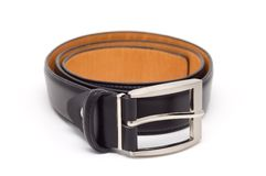 Leather belt with a metal buckle. Royalty Free Stock Photos
