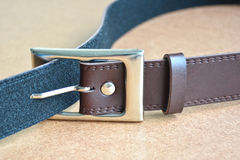 Leather belt with metal buckle. Stock Photos