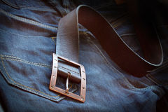 Leather belt over a pair of jeans Stock Photo